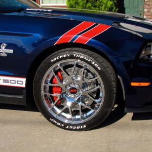 American Muscle chrome AMR wheels (no longer available) plus Disc Italia drilled/slotted radials and Mickey Thompson ULP Street Comps with added raise